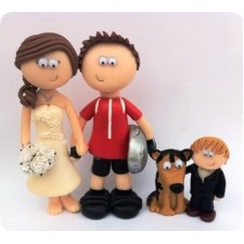 Wedding cake toppers with child and dog