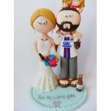 Tatooed wedding cake topper