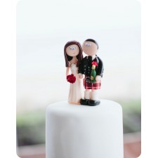 Scottish wedding cake topper in action