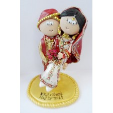 Indian Groom carrying his Bride cake topper