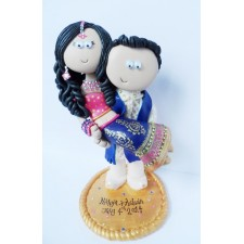 Groom carrying bride Asian cake topper