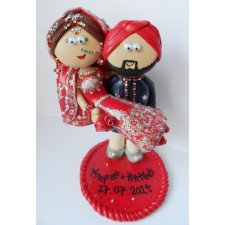 Indian wedding cake topper Groom carrying Bride