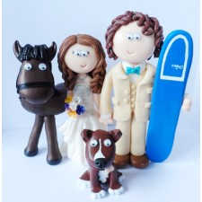 Surfing wedding cake topper with horse and dog