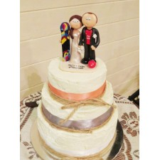 Snowboarder and football wedding topper on cake
