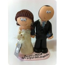 Bride and groom iPhone and shopping wedding cake topper
