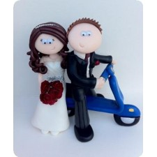 Bride and groom on scooter wedding cake toppers