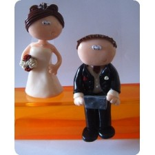 Laptop loving wedding cake topper