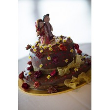 Indian wedding cake topper on the cake