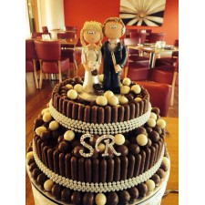 Chocoholic Bride & Drummer Groom wedding cake topper on cake